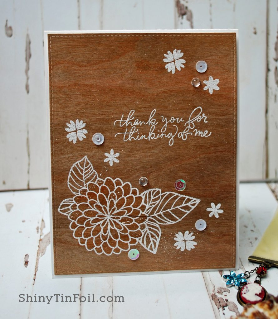 card embossed on wood veneer