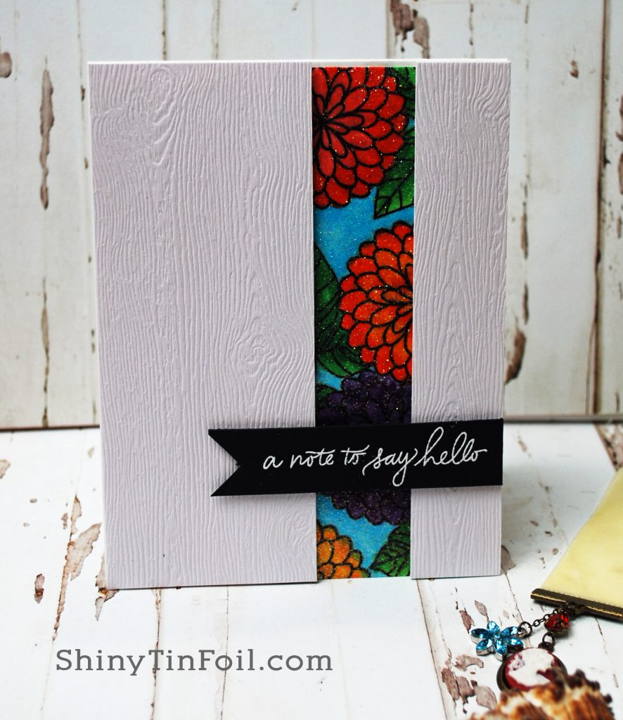 woodgrain card with glittered flowers